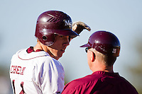 Eric Cheray (14) of the Missouri State Bears talks with first base coach Brent Thomas (20) during a game against the Southern Illinois University- Edwardsville Cougars at Hammons Field on March 10, 2012 in Springfield, Missouri. (David Welker / Four Seam Images)