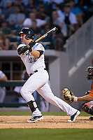 Matt Davidson (22) of the Charlotte Knights follows through on his swing against the Norfolk Tides at BB&T BallPark on April 9, 2015 in Charlotte, North Carolina.  The Knights defeated the Tides 6-3.   (Brian Westerholt/Four Seam Images)