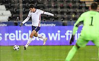 SWANSEA, WALES - NOVEMBER 12: Giovanni Reyna #7 of the United States  sends a crossing ball into the box during a game between Wales and USMNT at Liberty Stadium on November 12, 2020 in Swansea, Wales.
