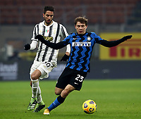 Calcio, Serie A: Inter Milano - Juventus FC , Giuseppe Meazza (San Siro) stadium, in Milan, January 17, 2021.<br /> Inter's Nicolò Barella (r) in action with Juventus'Rodrigo Bentancur (l) during the Italian Serie A football match between Inter and juventus at Giuseppe Meazza (San Siro) stadium, January 17,  2021.<br /> UPDATE IMAGES PRESS/Isabella Bonotto