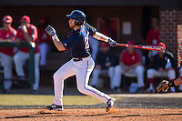 Austin Allison (26) of the Shippensburg Raiders follows through on his swing against the Belmont Abbey Crusaders at Abbey Yard on February 8, 2015 in Belmont, North Carolina.  The Raiders defeated the Crusaders 14-0.  (Brian Westerholt/Four Seam Images)