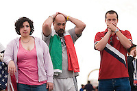Soccer fans Annemarie Tartaglia, John Russo, and Ray Olives. show various levels of anxiety in the wanning moments of the game. The Red Bulls hosted a FIFA World Cup viewing party for the USA v Italy match at the Giants Stadium practice bubble, East Rutherford, NJ, June 17, 2006.