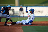 St. Lucie Mets second baseman Luis Carpio (11) slides into second base as Tristan Gray (9) applies the tag during the first game of a doubleheader against the Charlotte Stone Crabs on April 24, 2018 at First Data Field in Port St. Lucie, Florida.  St. Lucie defeated Charlotte 5-3.  (Mike Janes/Four Seam Images)