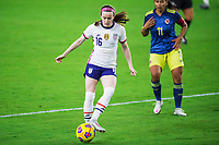 ORLANDO, FL - JANUARY 18: Rose Lavelle #15 of the USWNT kicks the ball during a game between Colombia and USWNT at Exploria Stadium on January 18, 2021 in Orlando, Florida.