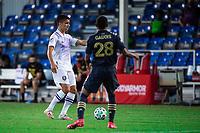LAKE BUENA VISTA, FL - JULY 20: Joao Moutinho #4 of Orlando City SC dribbles the ball during a game between Orlando City SC and Philadelphia Union at Wide World of Sports on July 20, 2020 in Lake Buena Vista, Florida.