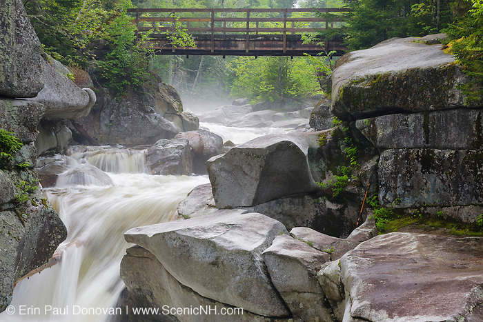 Upper Ammonoosuc Falls on the Ammonoosuc River in Crawford's Purchase, New Hampshire on a foggy spring morning. These falls are a roadside attraction along Base Road.