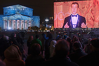 Moscow, Russia, 28/10/2011..Russian President Dmitri Medvedev speaking on the Bolshoi Theatre main stage is relayed to giant outdoor video screens on Ploschad Revolutsii, where crowds gathered to watch the reopening of the theatre.  It had had been closed since 2005 for reconstruction work that cost some $700 million.