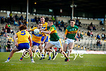 Seán O'Shea, Kerry, in action against Cian O Dea, Clare, and Cillian Brennan, Clare, during the Munster Football Championship game between Kerry and Clare at Fitzgerald Stadium, Killarney on Saturday.