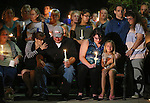 Grief-stricken family members of a Carson City Sheriff's deputy killed in the line of duty early Saturday attend a candlelight vigil in Carson City, Nev., on Saturday night, Aug. 15, 2015. Hundreds of residents came out to show their support for the family and department. <br /> Photo by Cathleen Allison
