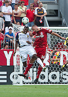 29 June 2013: Toronto FC forward Danny Koevermans #14 and Real Salt Lake defender Aaron Maund #4 in action during an MLS game between Real Salt Lake and Toronto FC at BMO Field in Toronto, Ontario Canada.