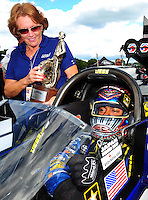 Aug. 21, 2011; Brainerd, MN, USA: NHRA top fuel dragster driver Antron Brown (right) is presented the trophy by Charlotte Lucas after winning the Lucas Oil Nationals at Brainerd International Raceway. Mandatory Credit: Mark J. Rebilas-