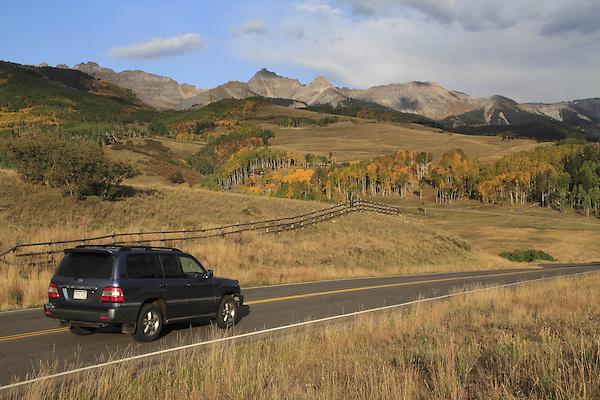 Sedan on highway in San Juan Mountains near Telluride, Colorado, USA.