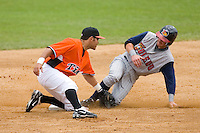 Don Kelly #8 of the Toledo Mudhens beats the tag of shortstop Carlos Rojas #12 of the Norfolk Tides as he steals second base at Harbor Park June 7, 2009 in Norfolk, Virginia. (Photo by Brian Westerholt / Four Seam Images)