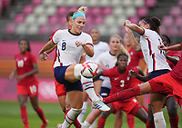 KASHIMA, JAPAN - AUGUST 2: Julie Ertz #8 of the United States kicks the ball during a game between Canada and USWNT at Kashima Soccer Stadium on August 2, 2021 in Kashima, Japan.