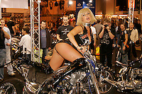 A model cavorts on a custom motorbike at the Bike Show, held at Birmingham's NEC