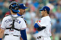 Round Rock Express pitcher Martin Perez #45 talks with pitching coach Terry Clark during a game against the New Orleans Zephyrs at the Dell Diamond on July 21, 2011 in Round Rock, Texas.  New Orleans defeated Round Rock 7-4.  (Andrew Woolley/Four Seam Images)