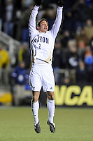 Akron Zips Zarek Valentin (2) celebrates converting a penalty kick during the penalty kick shootout. The Akron Zips defeated the North Carolina Tar Heals 5-4 in penalty kicks after playing a scoreless game during the second semi-final match of the 2009 NCAA Men's College Cup at WakeMed Soccer Park in Cary, NC on December 11, 2009.