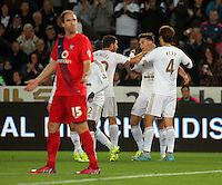Pictured: Matt Grimes of Swansea (C) celebrates his goal with team mates Angel Rangel and Ki Sung Yueng Tuesday 25 August 2015<br /> Re: Capital One Cup, Round Two, Swansea City v York City at the Liberty Stadium, Swansea, UK.
