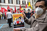 Rome, Italy. 01st May, 2021. Today, hundreds of people, led by CUB Trasporti and USB Trade Unions and extra-parliamentary lefty Parties, gathered in Piazza Santi Apostoli to celebrate the MayDay, International Workers' Day 2021. The topics discussed at the rally, held under pandemic Coronavirus / Covid-19 demonstration restrictions, were various including: the Alitalia crisis, the flag carrier of Italy at risk to be dismantled (1.); Public School, Healthcare and Public Administration/Sector situations; the Italian economic and government situation during the ongoing pandemic Coronavirus / Covid-19; Internationalism, workers' rights and struggles in the world. Finally the rally was organised in support and solidarity with the other demonstrations across the globe.<br />