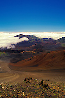 Looking due east from the main visitor center in Haleakala National Park (at a 9,745-ft. elevation). An enormous errotional depression, not considered a crater, spans seven miles to the eastern ridgeline with numerous cinder cones in the foreground.