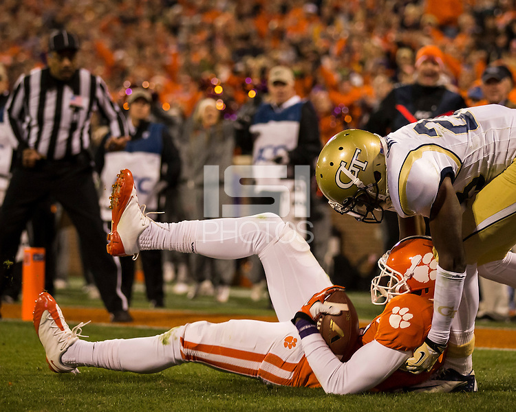 The eighth ranked Clemson Tigers defeat the Georgia Tech Yellow Jackets at Death Valley 55-31 in an ACC matchup.  Clemson Tigers wide receiver Mike Williams (7) catches a touchdown pass over Georgia Tech Yellow Jackets cornerback D.J. White (28)