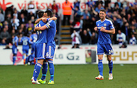 Sunday, 13 April 2014<br /> Pictured L-R: Oscar, John terry and Gary Cahill of Chelsea celebrating the goal score by their team mate Demba Ba. <br /> Re: Barclay's Premier League, Swansea City FC v Chelsea at the Liberty Stadium, south Wales,