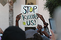 One demonstrator carried a simple sign in El Cajon, California, a suburb of San Diego, 09/28/16, as some 300 demonstrators gathered to honor an African American man, Alfredo Olango, who was killed by police the night before.