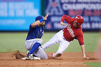 GCL Blue Jays second baseman Alfredo Bohorquez (13) tags out Mickey Moniak (right) attempt to steal second during a game against the GCL Phillies on August 16, 2016 at Bright House Field in Clearwater, Florida.  GCL Blue Jays defeated GCL Phillies 2-1.  (Mike Janes/Four Seam Images)