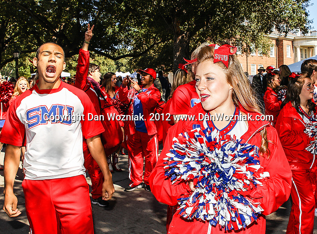 Southern Methodist Mustangs cheerleaders celebrate homecoming before the game between the Memphis Tigers and the Southern Methodist Mustangs at the Gerald J. Ford Stadium in Dallas, Texas. SMU defeats Memphis 44 to 13.