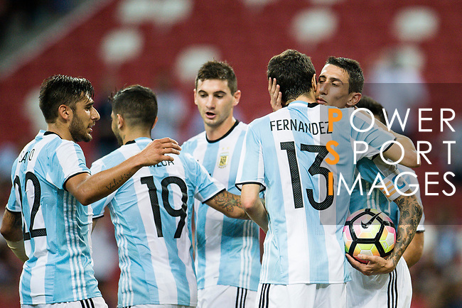 Angel Di Maria of Argentina (R) celebrates with teammates after scoring his goal during the International Test match between Argentina and Singapore at National Stadium on June 13, 2017 in Singapore. Photo by Marcio Rodrigo Machado / Power Sport Images