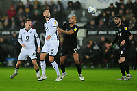 Mike van der Hoorn of Swansea City vies for possession with Darren Pratley of Charlton Athletic during the Sky Bet Championship match between Swansea City and Charlton Athletic at the Liberty Stadium in Swansea, Wales, UK.  Thursday 02 January 2020