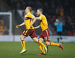 Henrik Ojamaa scores for Motherwell and celebrates withn Mark O'Brien