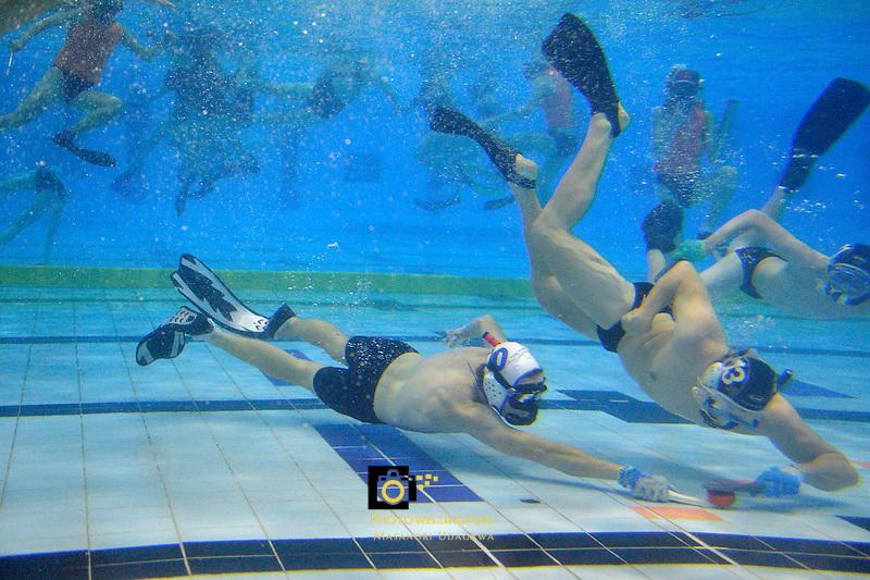 Action from the Underwater Hockey Premier  at Wellington Regional Aquatic Centre, Wellington, New Zealand on Tuesday 3  June 2014. <br /> Photo by Masanori Udagawa. <br /> www.photowellington.photoshelter.com.