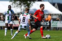 LEEK - Voetbal, Pelikaan S - FC Groningen , voorbereiding seizoen 2021-2022, oefenduel, 03-07-2021,  Pelikaan S speler Johnny de Vries met FC Groningen speler Michael de Leeuw