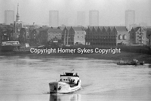 London Docklands Development 1980s UK. View across River Thames towards Rotherhithe, St Mary's Church new flats being built.1987 England.