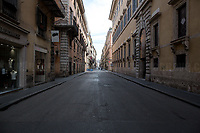 """Via del Corso.<br /> <br /> Rome, 12/03/2020. Documenting Rome under the Italian Government lockdown for the Outbreak of the Coronavirus (SARS-CoV-2 - COVID-19) in Italy. On the evening of the 11 March 2020, the Italian Prime Minister, Giuseppe Conte, signed the March 11th Decree Law """"Step 4 Consolidation of 1 single Protection Zone for the entire national territory"""" (1.). The further urgent measures were taken """"in order to counter and contain the spread of the COVID-19 virus"""" on the same day when the WHO (World Health Organization, OMS in Italian) declared the coronavirus COVID-19 as a pandemic (2.).<br /> ISTAT (Italian Institute of Statistics) estimates that in Italy there are 50,724 homeless people. In Rome, around 20,000 people in fragile condition have asked for support. Moreover, there are 40,000 people who live in a state of housing emergency in Rome's municipality.<br /> March 11th Decree Law (1.): «[…] Retail commercial activities are suspended, with the exception of the food and basic necessities activities […] Newsagents, tobacconists, pharmacies and parapharmacies remain open. In any case, the interpersonal safety distance of one meter must be guaranteed. The activities of catering services (including bars, pubs, restaurants, ice cream shops, patisseries) are suspended […] Banking, financial and insurance services as well as the agricultural, livestock and agri-food processing sector, including the supply chains that supply goods and services, are guaranteed, […] The President of the Region can arrange the programming of the service provided by local public transport companies […]».<br /> Updates: on the 12.03.20 (6:00PM) in Italy there 14.955 positive cases; 1,439 patients have recovered; 1,266 died.<br /> <br /> Footnotes & Links:<br /> Info about COVID-19 in Italy: http://bit.do/fzRVu (ITA) - http://bit.do/fzRV5 (ENG)<br /> 1. March 11th Decree Law http://bit.do/fzREX (ITA) - http://bit.do/fzRFz (ENG)<br /> 2. http://bit.do/fzRKm"""