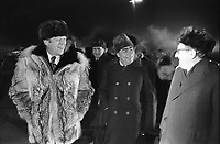 Photograph of President Gerald Ford, General Secretary Lenoid Brezhnev, and Henry Kissinger speaking informally at the conclusion of the Vladivostok Summit on the tarmac at Vozdvizhenka  Airport. Just moments after this photo was taken, President Ford informally concluded the Vladivostok Summit by giving his wolfskin coat to Secretary Brezhnev. NOV 1974