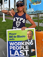 MIAMI, FLORIDA - JUNE 26: Protests outside prior to the first 2020 Democratic presidential debate including New York police officers that are protesting New York Mayor Bill de Blasio. A field of 20 Democratic presidential candidates was split into two groups of 10 for the first debate of the 2020 election, taking place over two nights at Knight Concert Hall of the Adrienne Arsht Center for the Performing Arts of Miami-Dade County on June 26, 2019 in Miami, Florida<br /> <br /> <br /> People:  Atmosphere