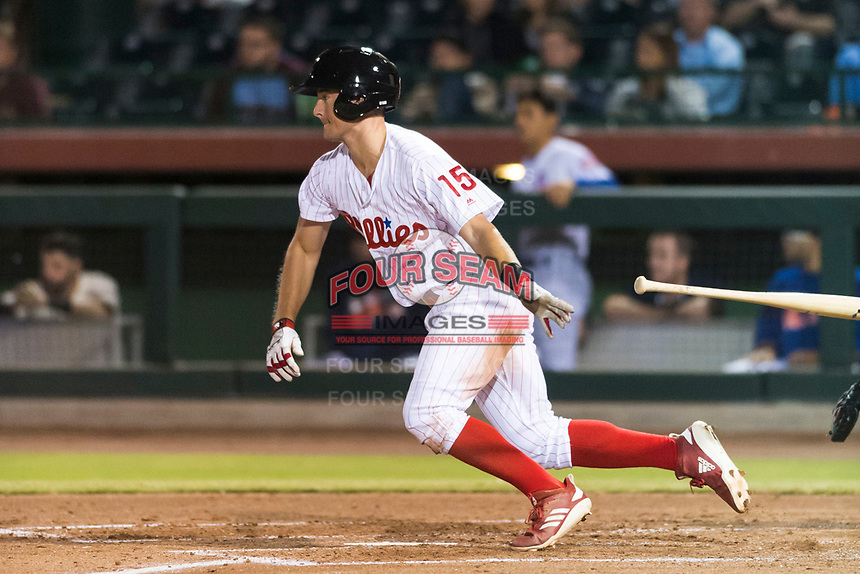 Scottsdale Scorpions right fielder Luke Williams (15), of the Philadelphia Phillies organization, releases his bat as he starts down the first base line during an Arizona Fall League game against the Surprise Saguaros at Scottsdale Stadium on October 15, 2018 in Scottsdale, Arizona. Surprise defeated Scottsdale 2-0. (Zachary Lucy/Four Seam Images)
