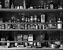 Ted Smallwood Store-medicine and products on shelves.