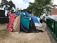 Due to the mild climate and subsidies such as free shelter, food, clothing & healthcare, homeless camps are a common site in downtown Austin, Texas.