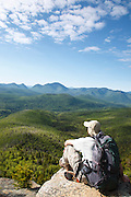 Zealand Notch  - A hiker takes in the view of the Pemigewasset Wilderness from the summit of Zeacliff during the summer months. Located along the Appalachian Trail in the White Mountains, New Hampshire.