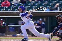 Matt Szczur (8) of the Iowa Cubs  swings at pitch against the New Orleans Zephyrs at Principal Park on April 23, 2015 in Des Moines, Iowa.  The Zephyrs won 9-2.  (Dennis Hubbard/Four Seam Images)