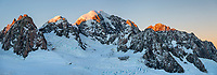 First light on second highest peak of Southern Alps, Mount Tasman 3497m in centre with Mt. Lendenfeld 3194m and Mount Haast 3114m on left and Torres Peak 3160m on right, Westland Tai Poutini National Park, West Coast, UNESCO World Heritage, New Zealand, NZ
