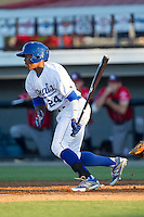 Alex Newman (24) of the Burlington Royals follows through on his swing against the Danville Braves at Burlington Athletic Park on July 5, 2014 in Burlington, North Carolina.  The Royals defeated the Braves 5-4.  (Brian Westerholt/Four Seam Images)