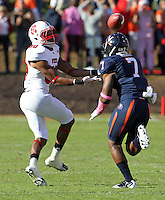 Oct. 22, 2011 - Charlottesville, Virginia - USA; North Carolina State wide receiver Bryan Underwood (80) makes a catch in front of Virginia Cavaliers safety Corey Mosley (7) during an NCAA football game at the Scott Stadium. NC State defeated Virginia 28-14. (Credit Image: © Andrew Shurtleff