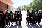 16 June 2013, Qala Wazir, Khoshal Khan, Kabul Province,  Afghanistan.  Students arriving for lessons at Shahid Nahid High School in Kabul.   Much of the funding for the school, including construction, was provided by the Education Quality Improvement Program (EQUIP). The school is benefitting from EQUIP whose objective is to increase access to quality basic education, especially for girls. School grants and teacher training programs are strengthened by support from communities and private providers.  Picture by Graham Crouch/World Bank