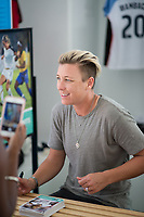 Orlando, FL - Saturday October 14, 2017: Abby Wambach signing autographs during the NWSL Championship match between the North Carolina Courage and the Portland Thorns FC at Orlando City Stadium.