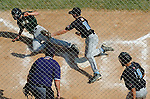 Aberdeen, MD: Jonathan Diaz (right) looks on as Dustyn Smith (left) slides into home plate and Josh Russo (middle) tries to get the tag out in time during Thursday's Tampa v Willamette Valley game at the 2009 Cal Ripken World Series