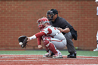 Grant Koch (33) of the Arkansas Razorbacks receives a pitch as home plate umpire Brent Cardwell looks on during the game against the Charlotte 49ers at Hayes Stadium on March 21, 2018 in Charlotte, North Carolina.  The 49ers defeated the Razorbacks 6-3.  (Brian Westerholt/Four Seam Images)